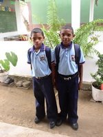 2 children in a school uniform in Colombia